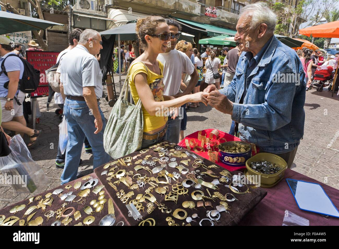 People shopping arts and crafts in nachlat binyamin market for Arts and crafts industry
