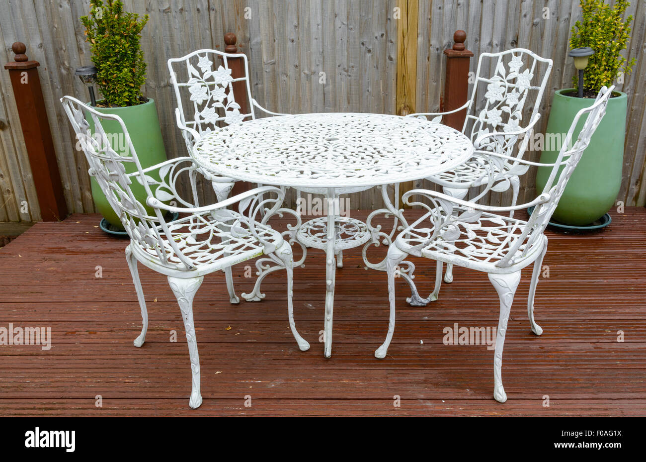 White cast iron garden table and chairs in a back garden for White iron garden furniture