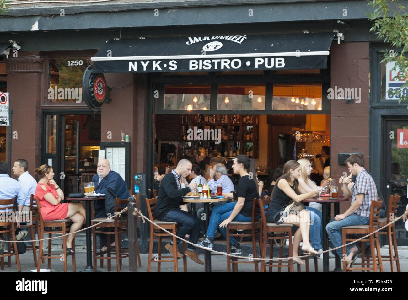 People sitting in front of NYKS Bistro and Pub, Montreal, Canada