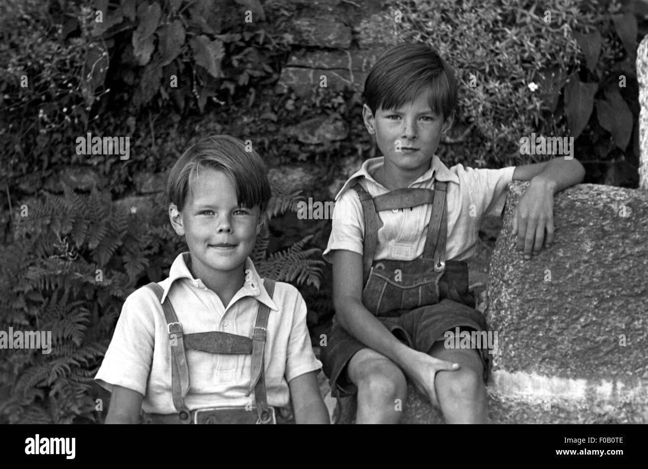 portrait of two boys wearing bavarian leather shorts stock