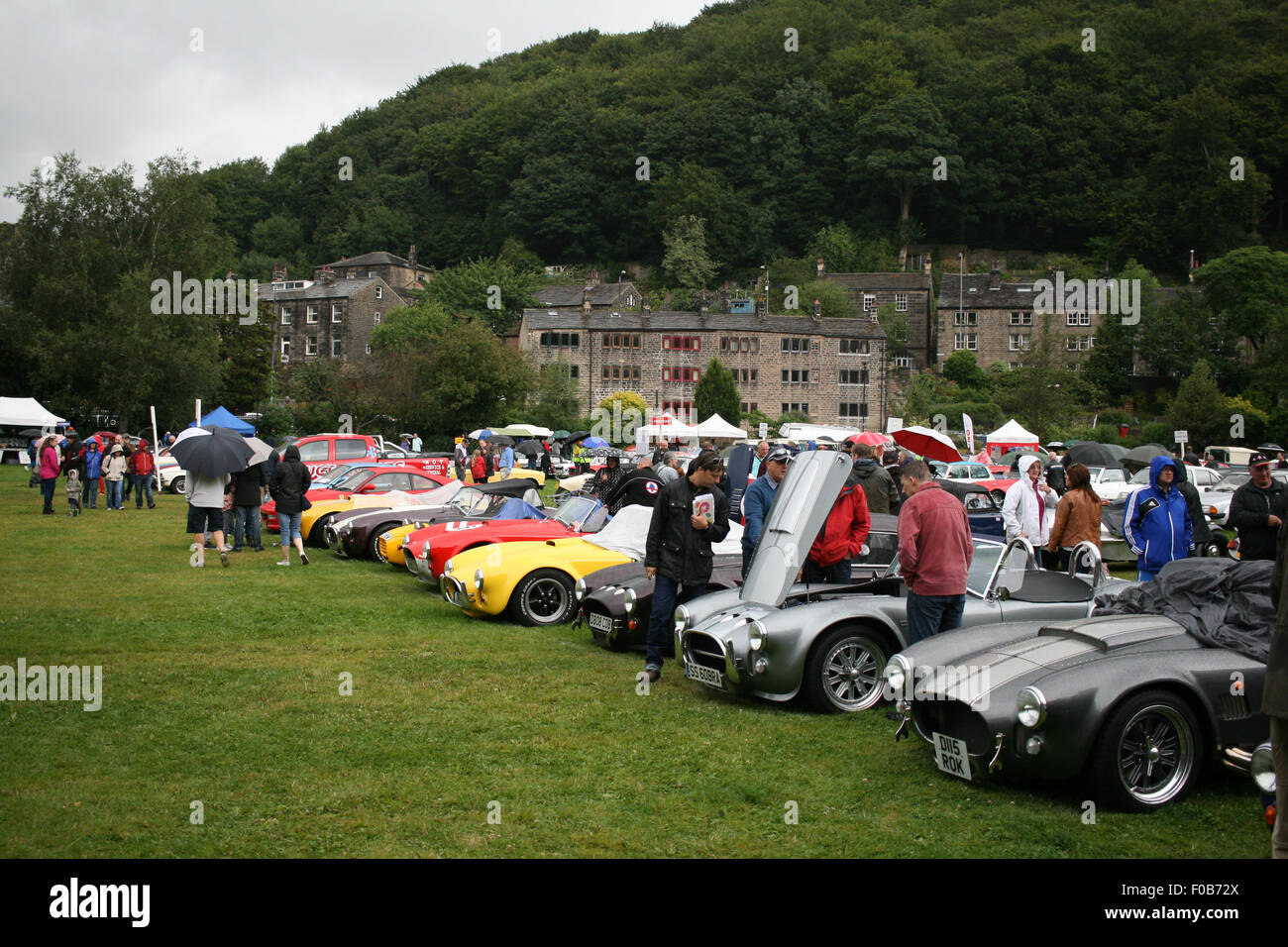 Row Of Classic Vintage Sports Cars At Show Outdoors In The Rain