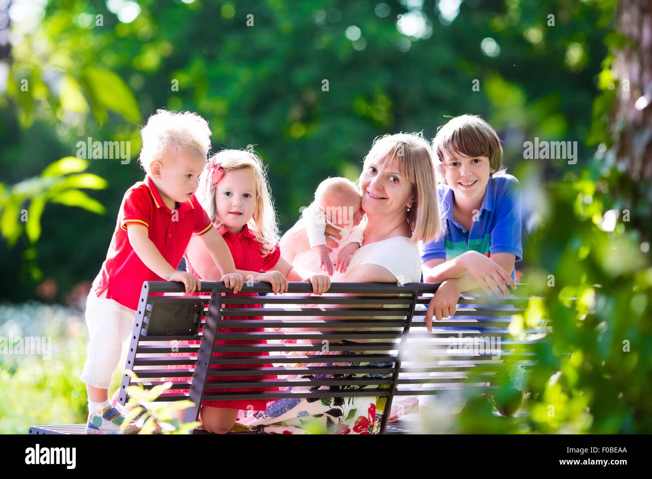 Grandmother And Grandchildren Enjoying Picnic In A Park