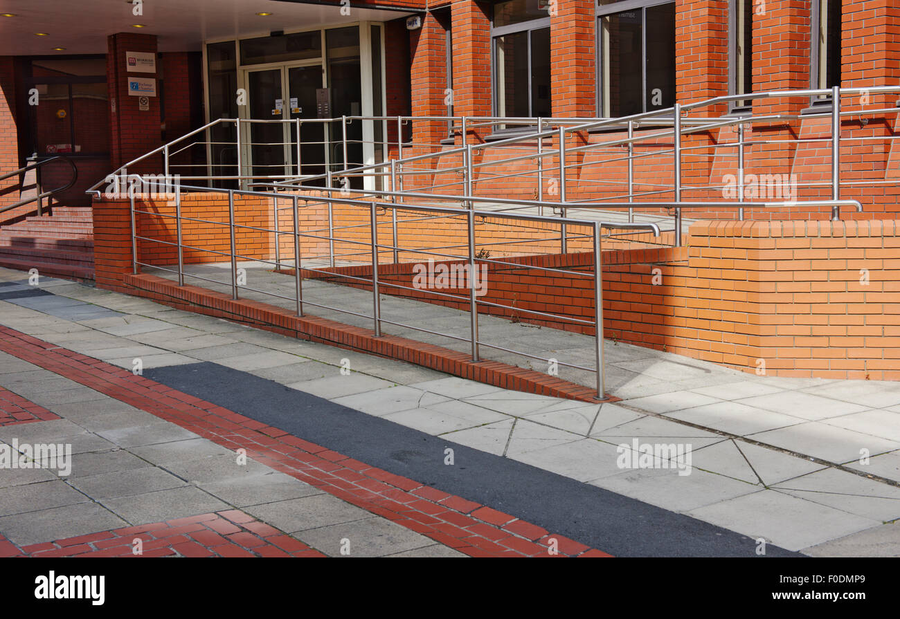 Disabled Access Ramp Next To Steps At Entrance To New