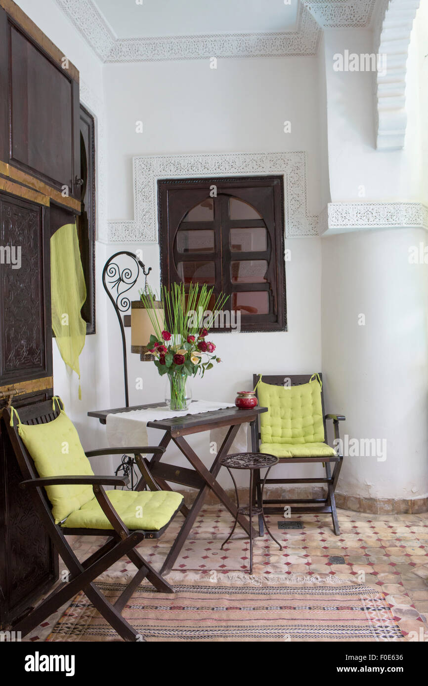 Interior view of an Arabian House interior with traditional furnitures,  carpets, Marrakech, Morocco, North Africa