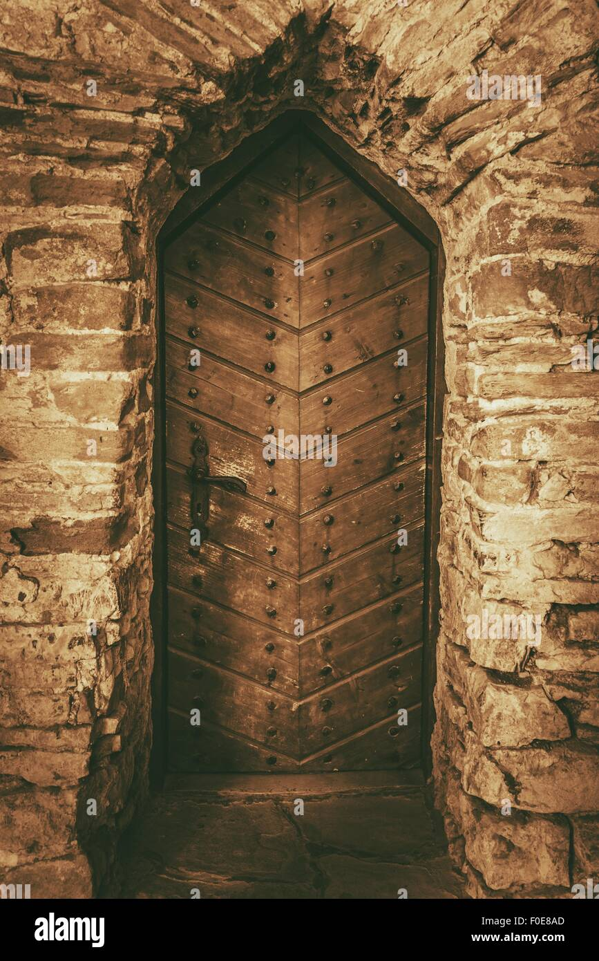 Vintage Wooden Castle Doors. Aged Stone Walls and the Medieval ...