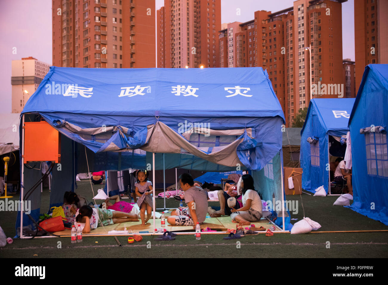 Temporary tents seen in a local school playground to & China. 14th Aug 2015. Temporary tents seen in a local school ...
