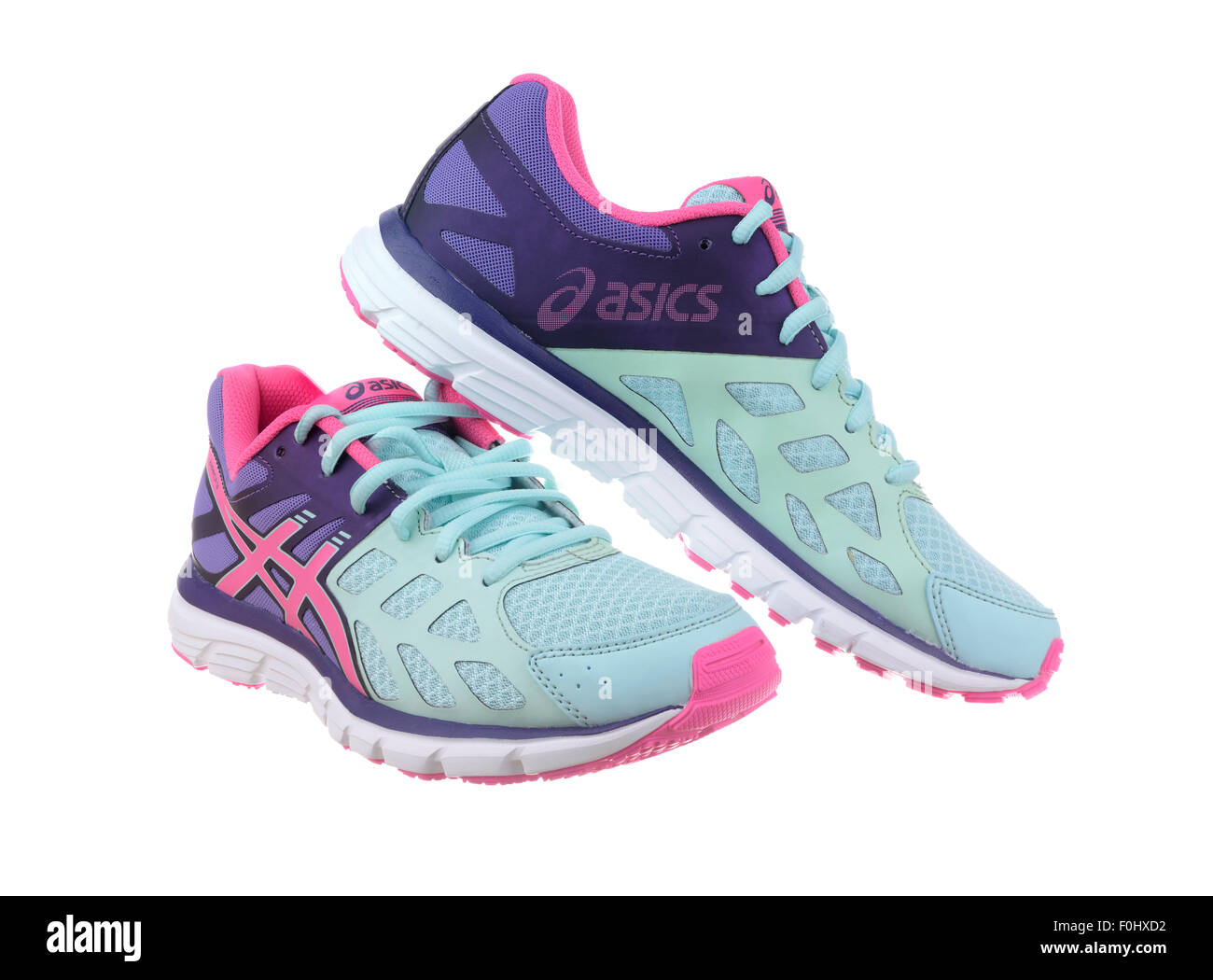 nike free run trainers blue\/pink background