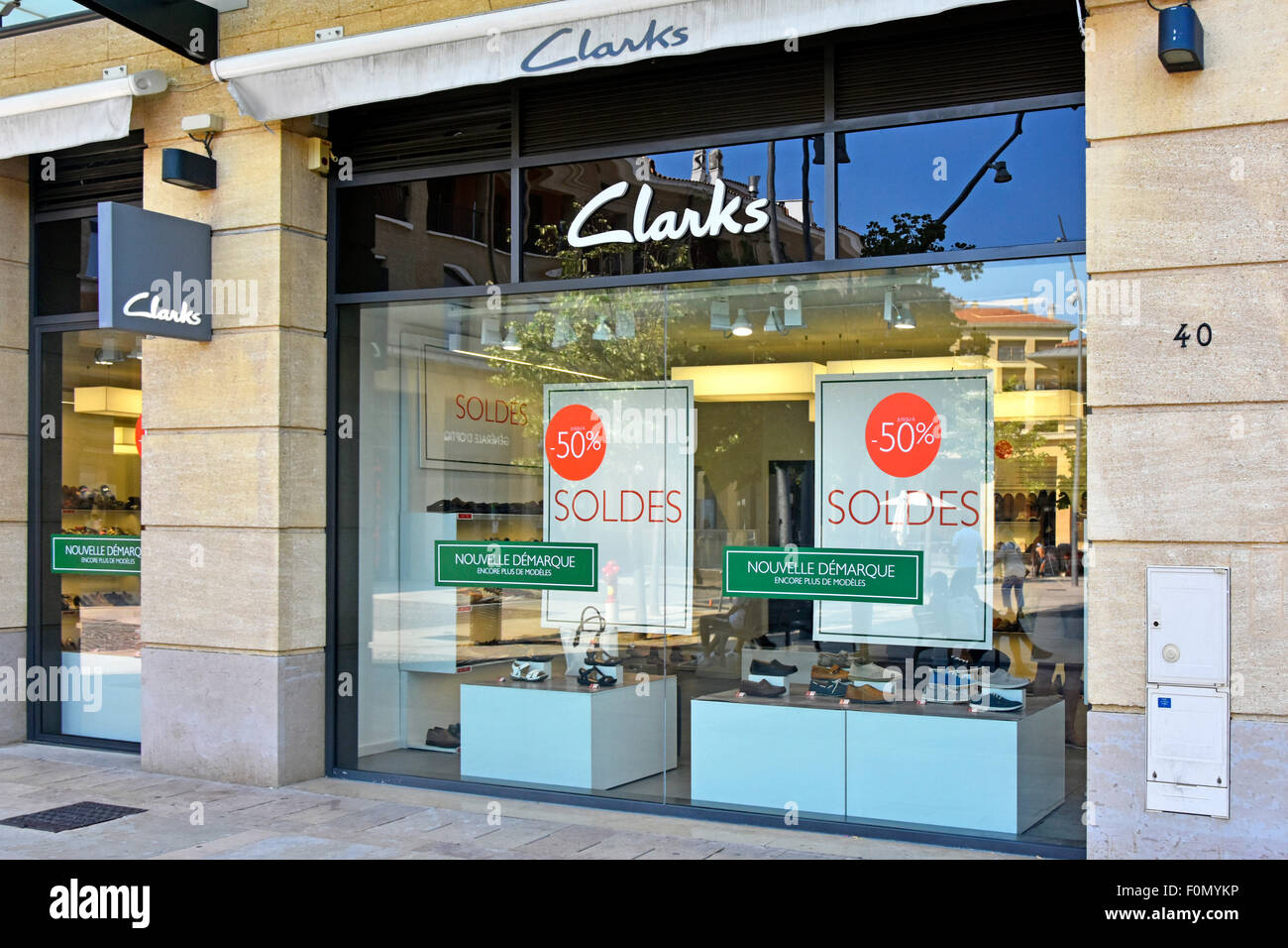 clarks shoes shopfront in aix en provence with 50 discount sale stock photo royalty free image. Black Bedroom Furniture Sets. Home Design Ideas