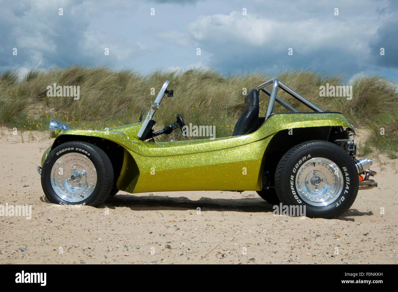 ... Photo - Beach buggy on a sandy beach. VW Beetle based dune buggy car