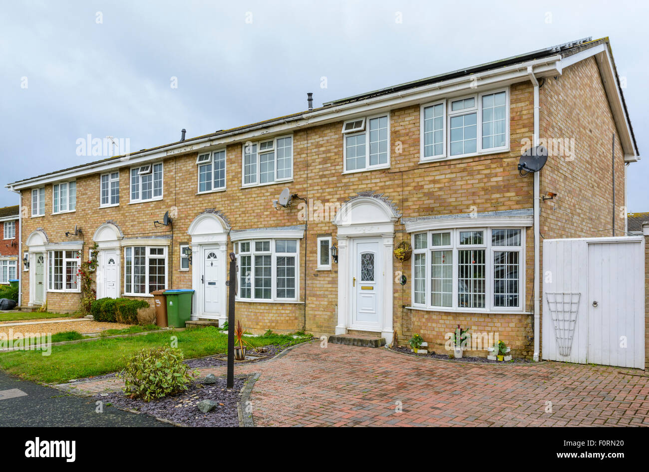 Row of modern terraced 2 storey brick houses in england uk stock image