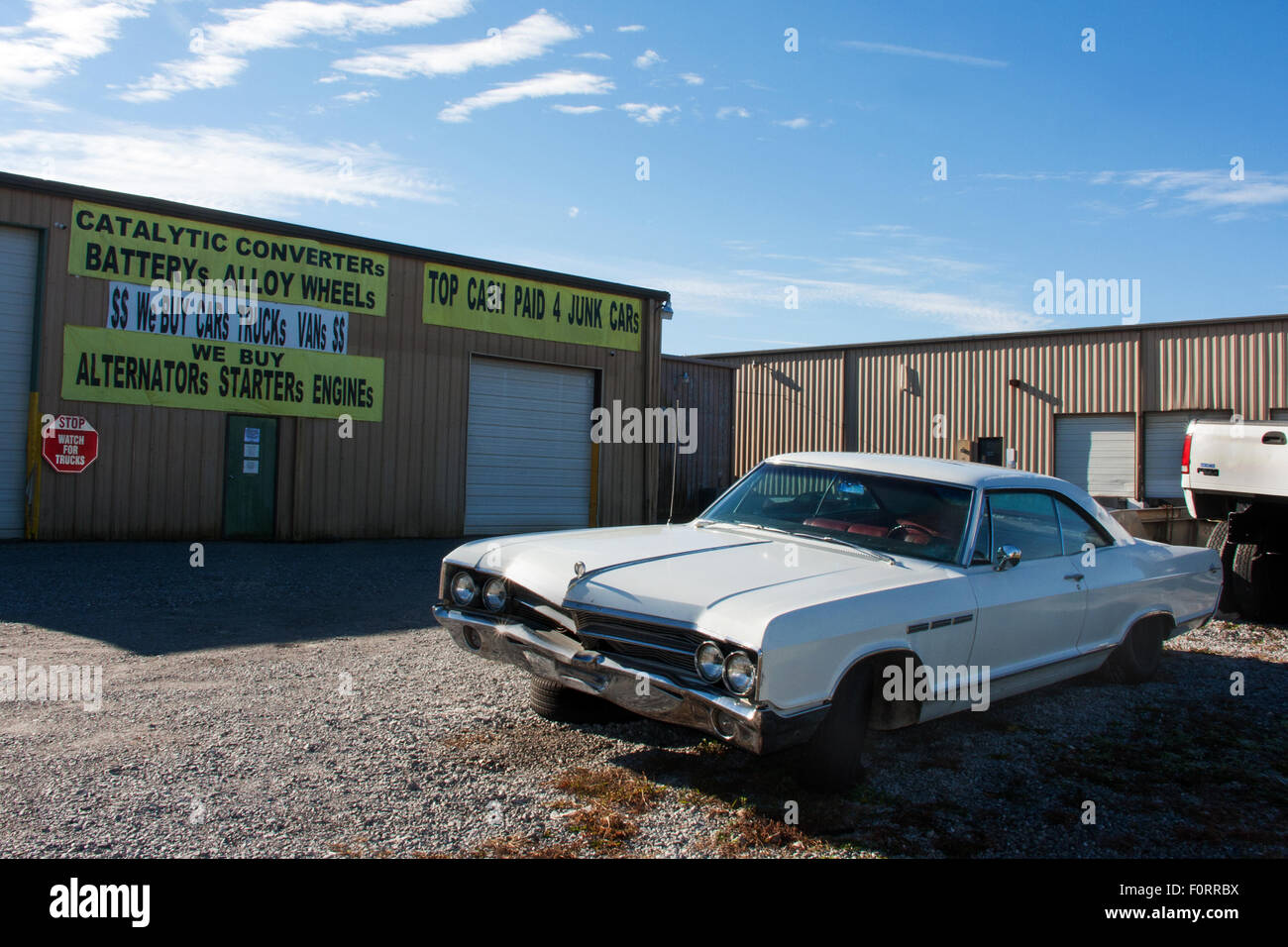 Abandoned Cars Buick LeSabre Awaits Its Fate Outside A - Dealer buick