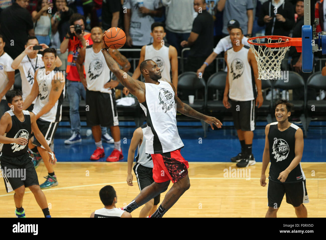 LeBron James soars for a dunk at the SM Mall of Arena in Pasay City, south  of Manila. The NBA superstar is in the country for the second