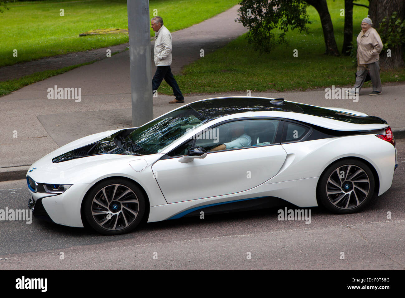 the 2015 model bmw i8 plug in hybrid sports car in white driving in stock photo royalty free. Black Bedroom Furniture Sets. Home Design Ideas