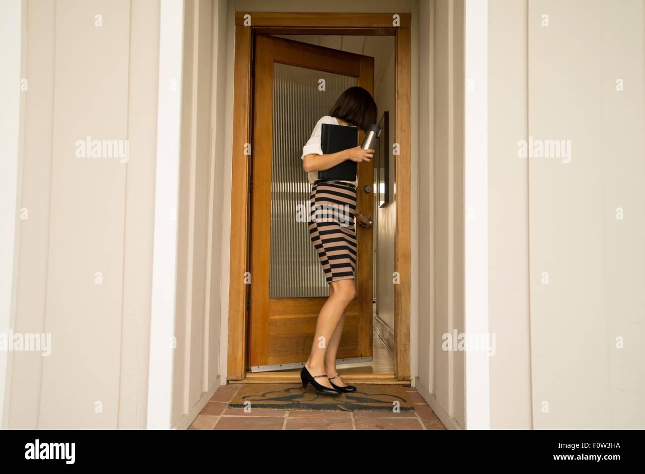 Businesswoman closing house front door & Businesswoman closing house front door Stock Photo: 86603478 - Alamy