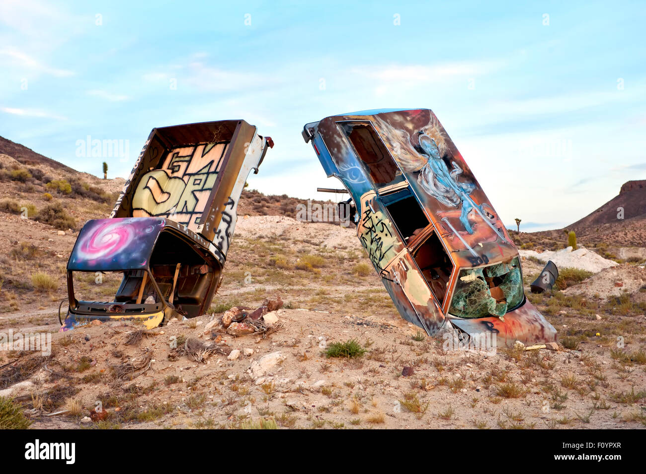 Junk cars artistically buried in the desert near Goldfield Nevada ...