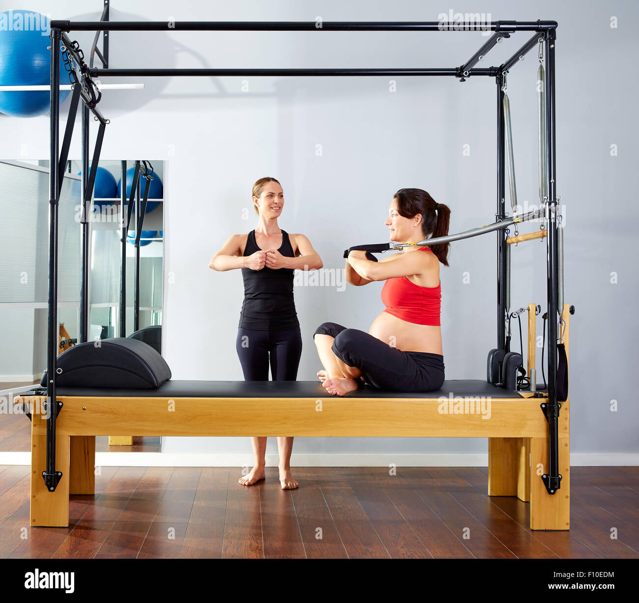Woman Pilates Chair Exercises Fitness Stock Photo: Pregnant Woman Pilates Reformer Cadillac Arms Exercise