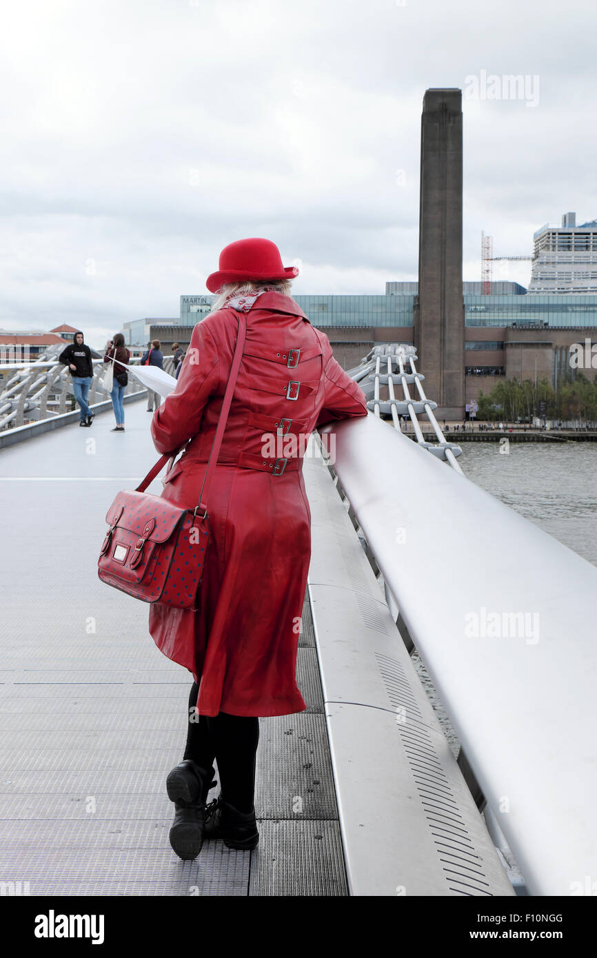 Rear View Of Tourist In Red Coat &amp Bowler Hat Standing On The