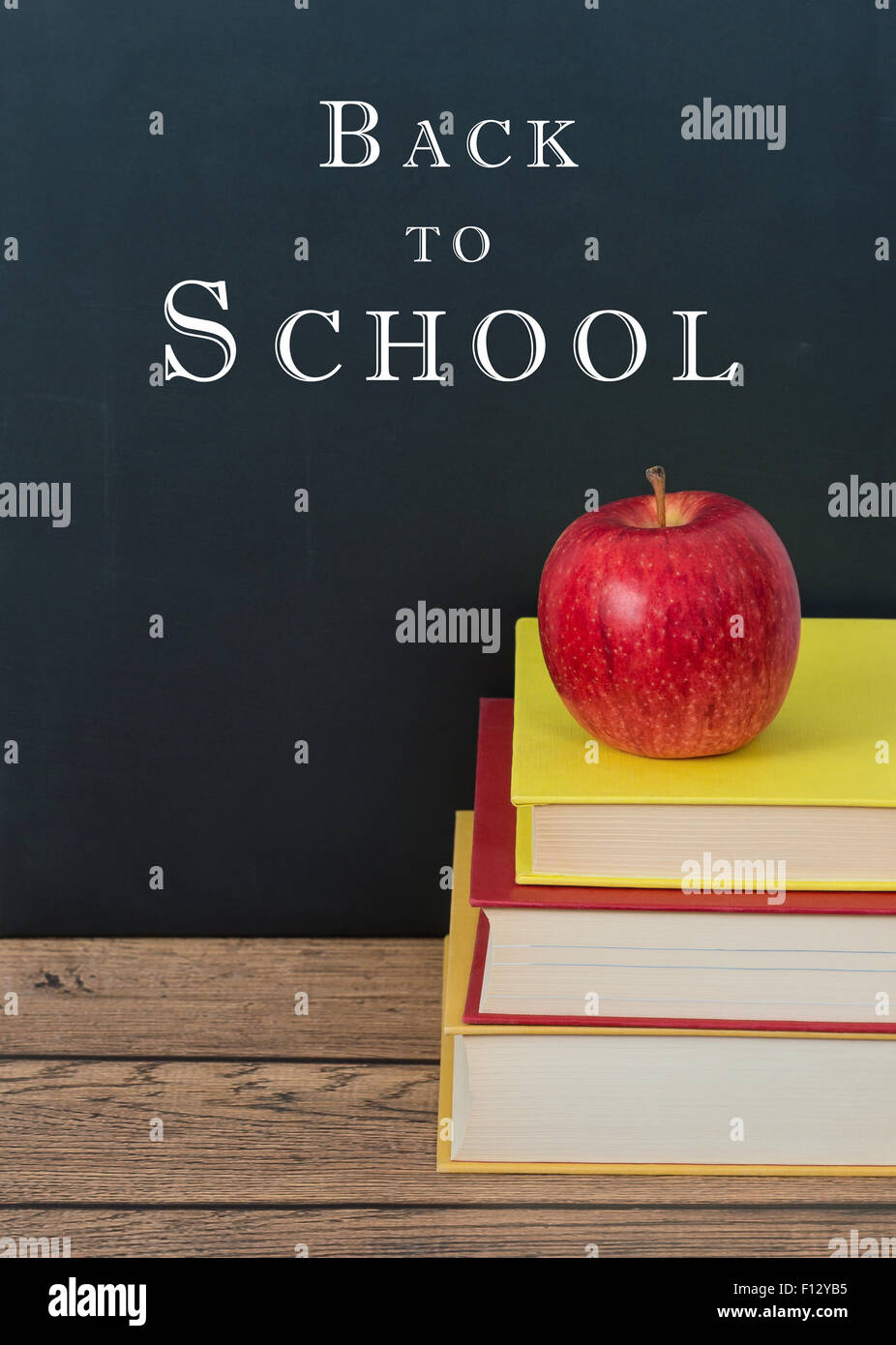 Red Apple On The Stack Of Books Chalkboard Background With Back To School Text