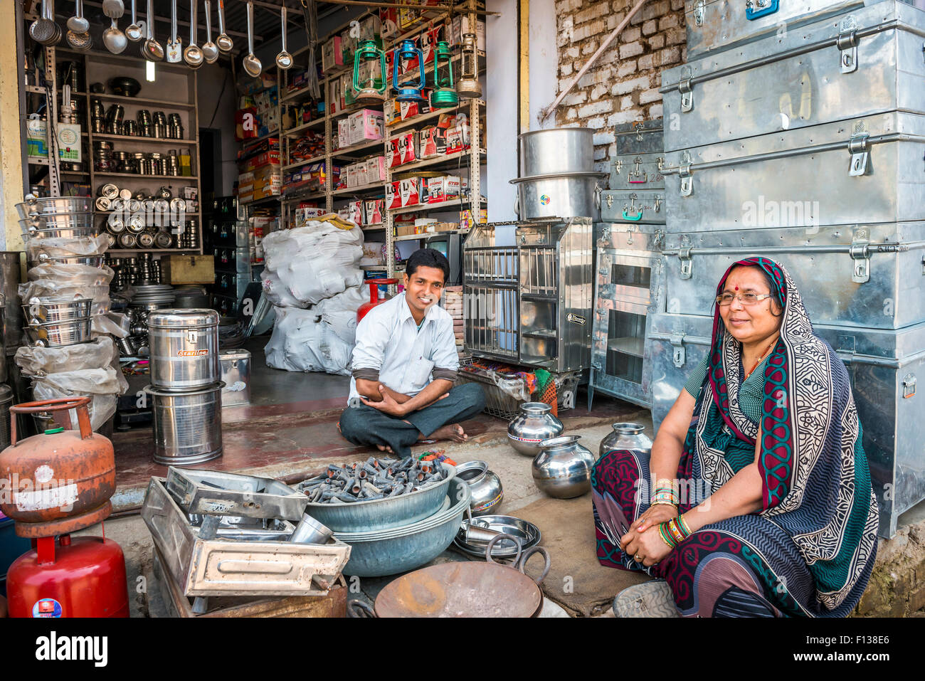 Sellers of metal goods and home wares in their shop in Chitrakoot    Chitrakut   Madhya Pradesh  India. Sellers of metal goods and home wares in their shop in Chitrakoot