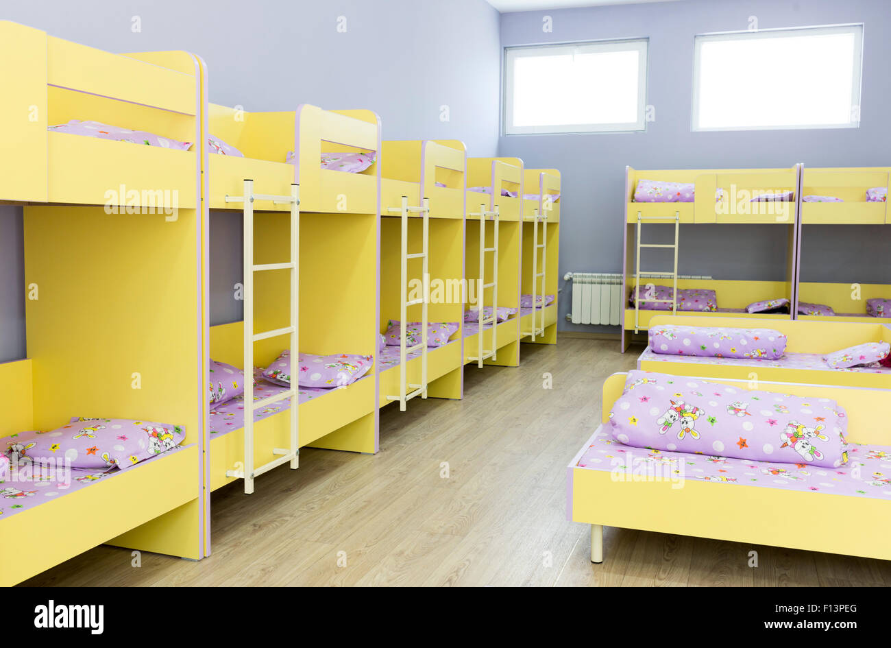 Modern Kindergarten Bedroom With Small Bunk Beds With Stairs For The Stock Photo Royalty Free