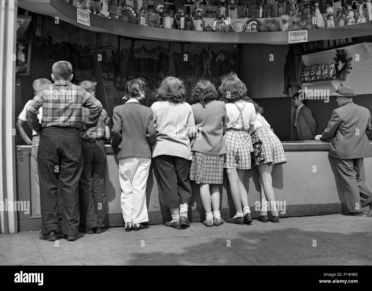 1940s LINE OF ANONYMOUS CHILDREN LINING COUNTER AT ...