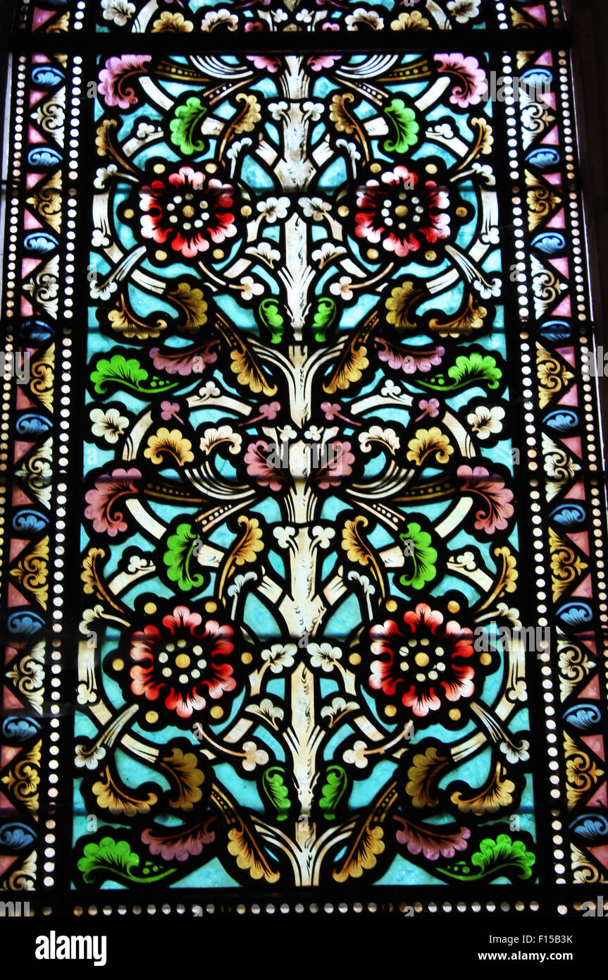 Pretty Detailed Stained Glass Window With Roses Flowers And Leaves Design I The 12the Century Church In Bourdeilles France