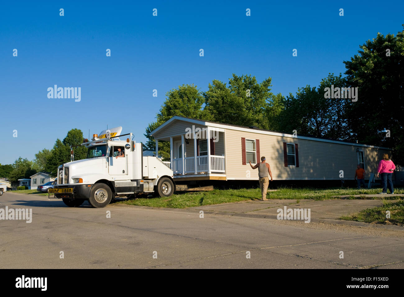 New Mobile Home Being Moved Into Place In Trailer Park
