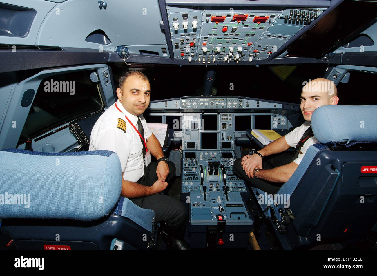 Oct 15 2014 sharjah emirate united arab emirates pilots aircraft airbus a 320 in the cockpit airport sharjah sharjah emirate uae credit image