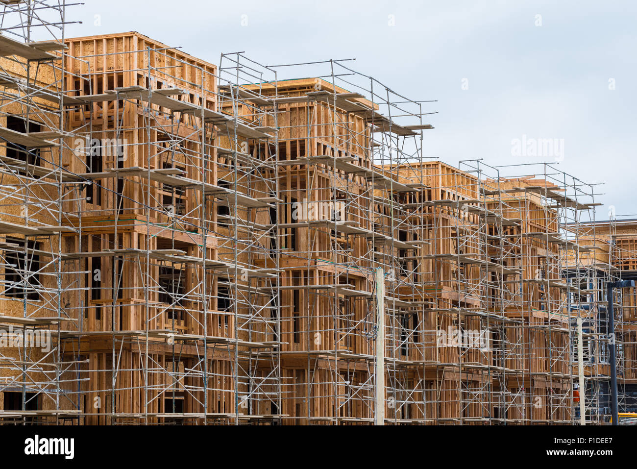 new wood frame apartment or condominium construction stock photo