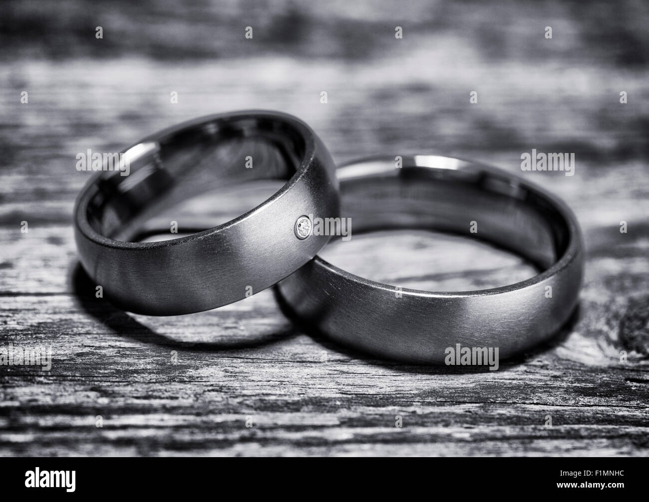 Pair Of Wedding Rings On Rustic Wooden Background Black And White Processing