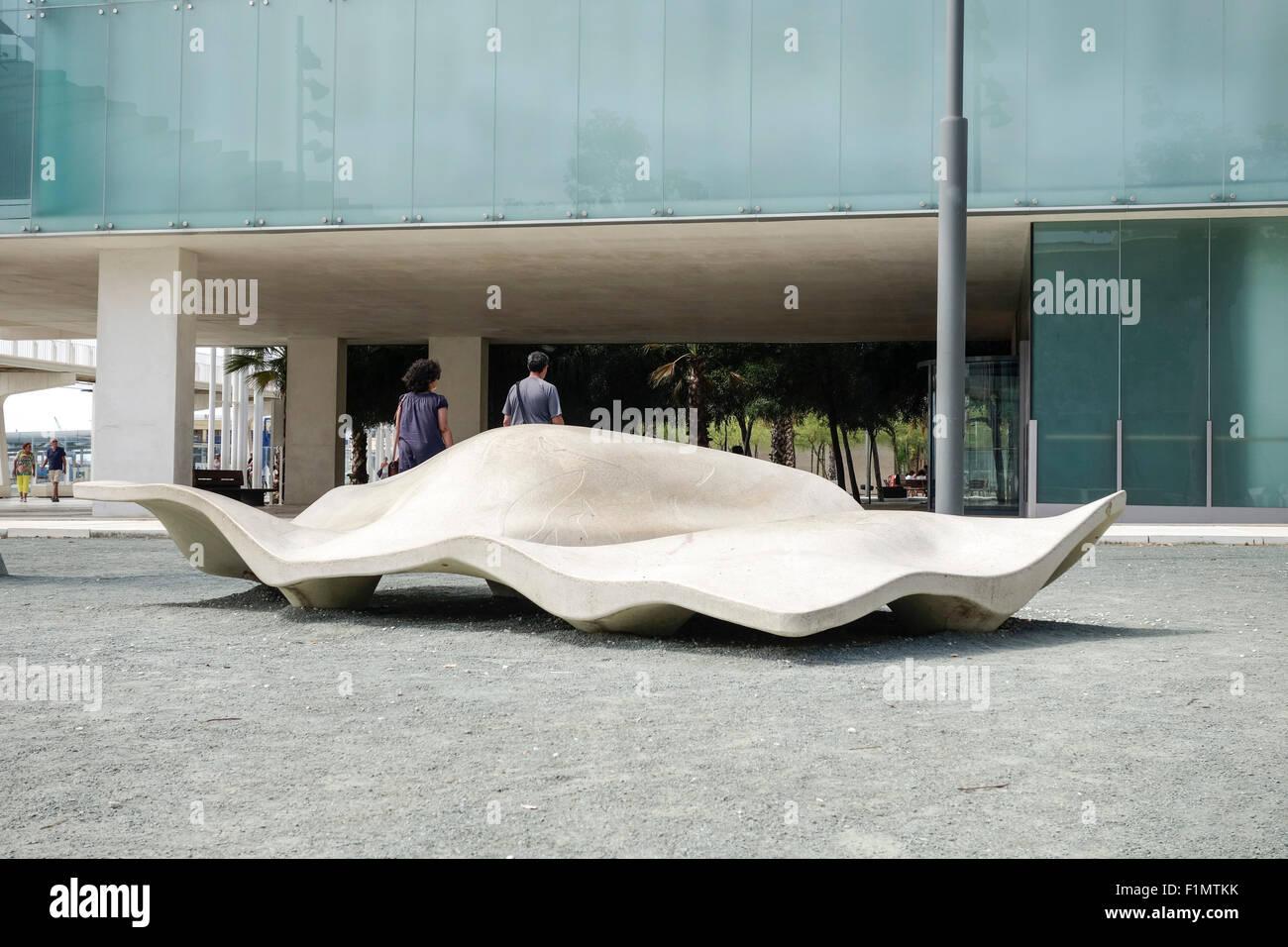 Modern urban furniture bench in front of museum of Alboran sea, Port of  Malaga, Andalusia, Spain.