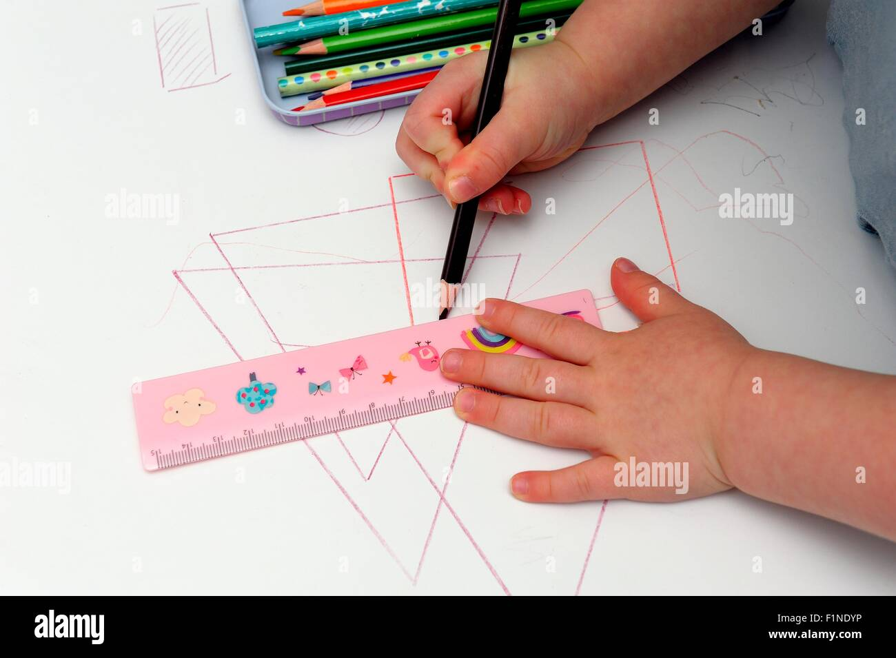 Drawing Lines Using A Ruler : A year old toddler girl using ruler to draw straight