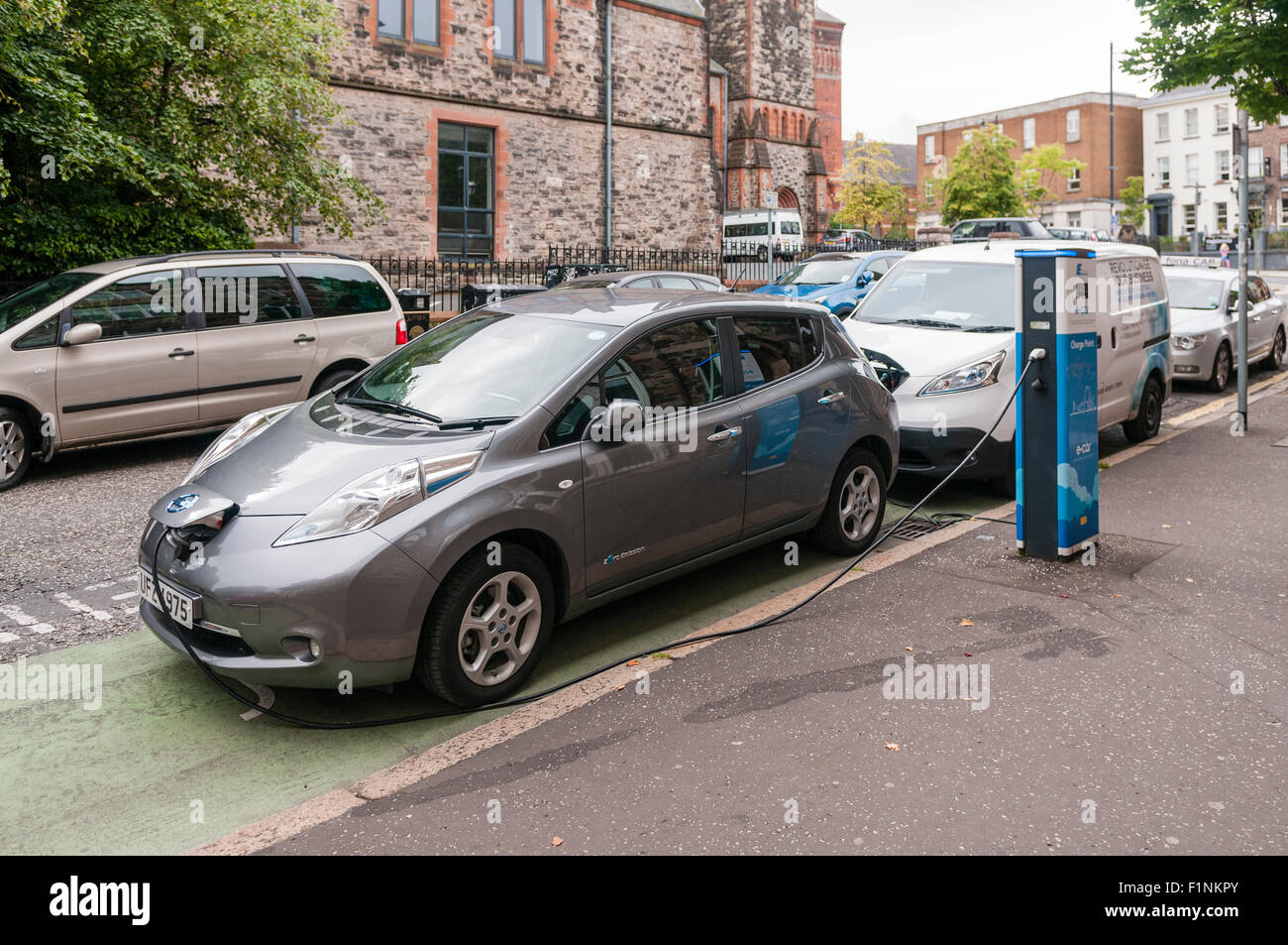 Nissan leaf electric car charging at an on street charging station stock image