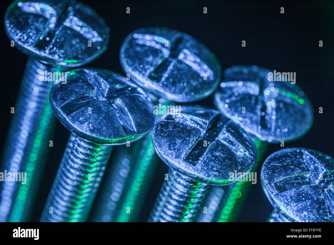 set of bolt heads taken under artificial lighting macro photo artificial lighting set