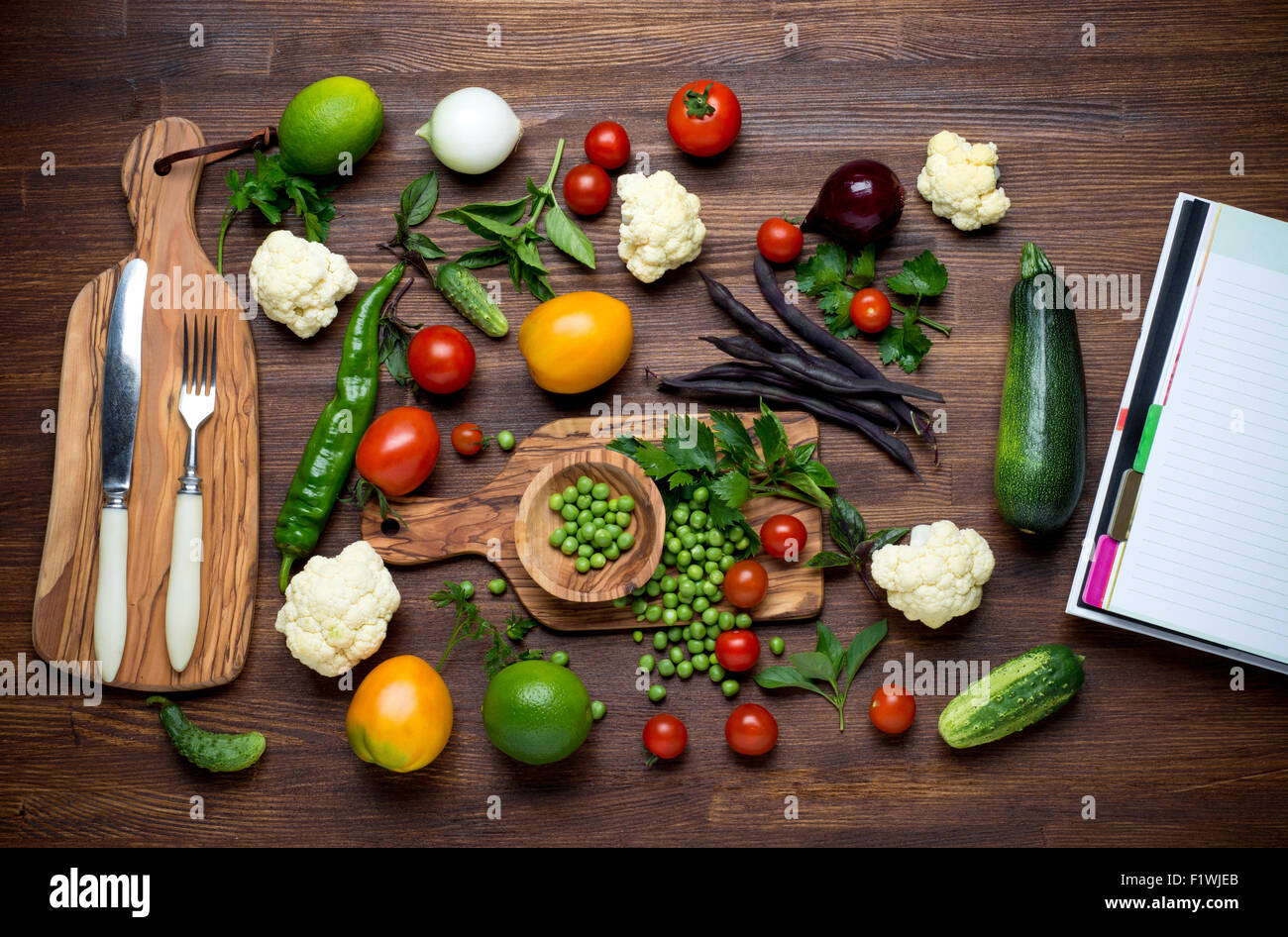 Healthy food herbs and vegetables on wooden table with recipe healthy food herbs and vegetables on wooden table with recipe book top view forumfinder