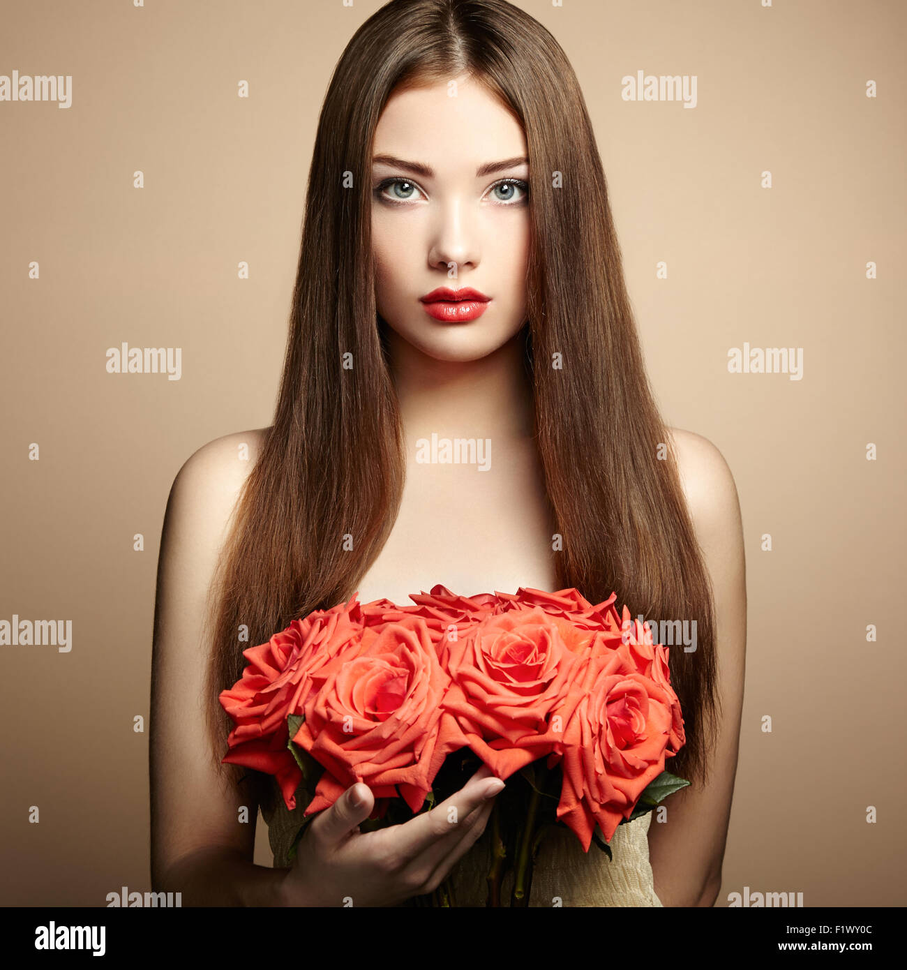 Portrait of beautiful dark haired woman with flowers fashion photo portrait of beautiful dark haired woman with flowers fashion photo izmirmasajfo Image collections