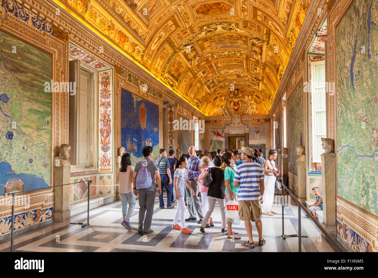 Tourists visiting The long Gallery of Maps in the Vatican Museums