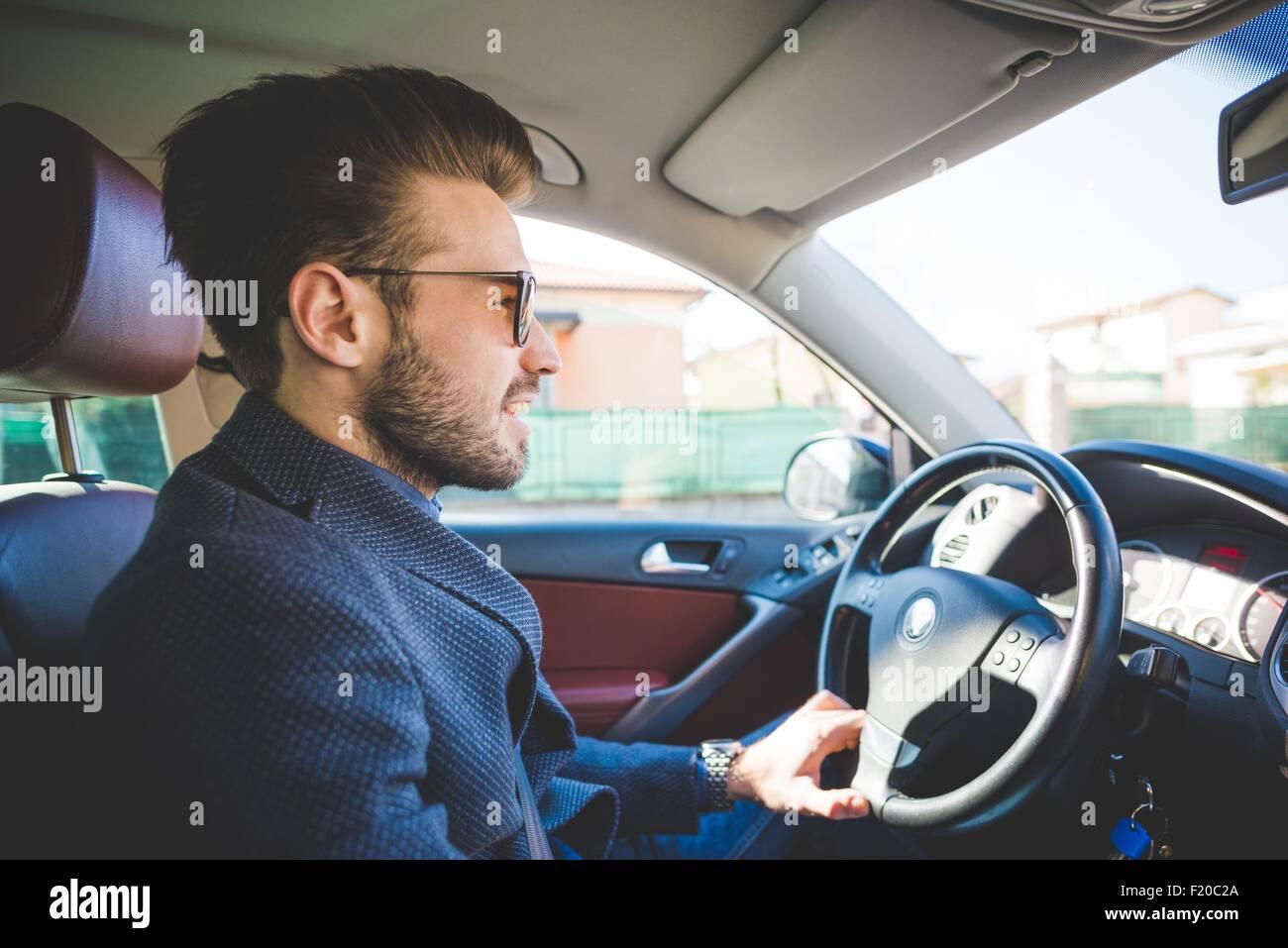 Stylish Young Man Driving Car