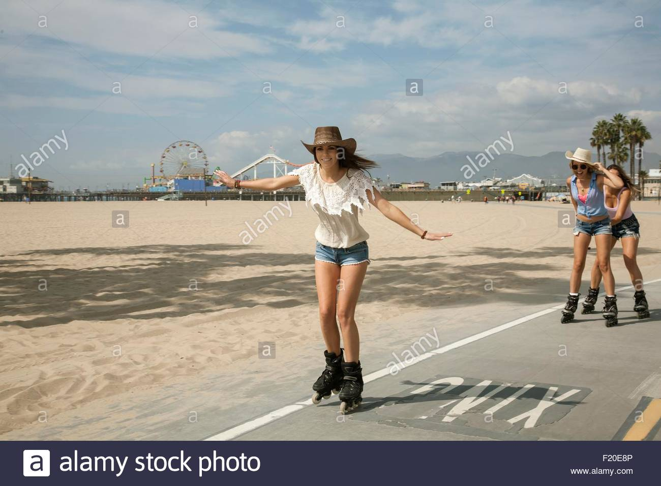 Roller skating los angeles - Three Young Women Inline Skating Santa Monica Los Angeles Usa