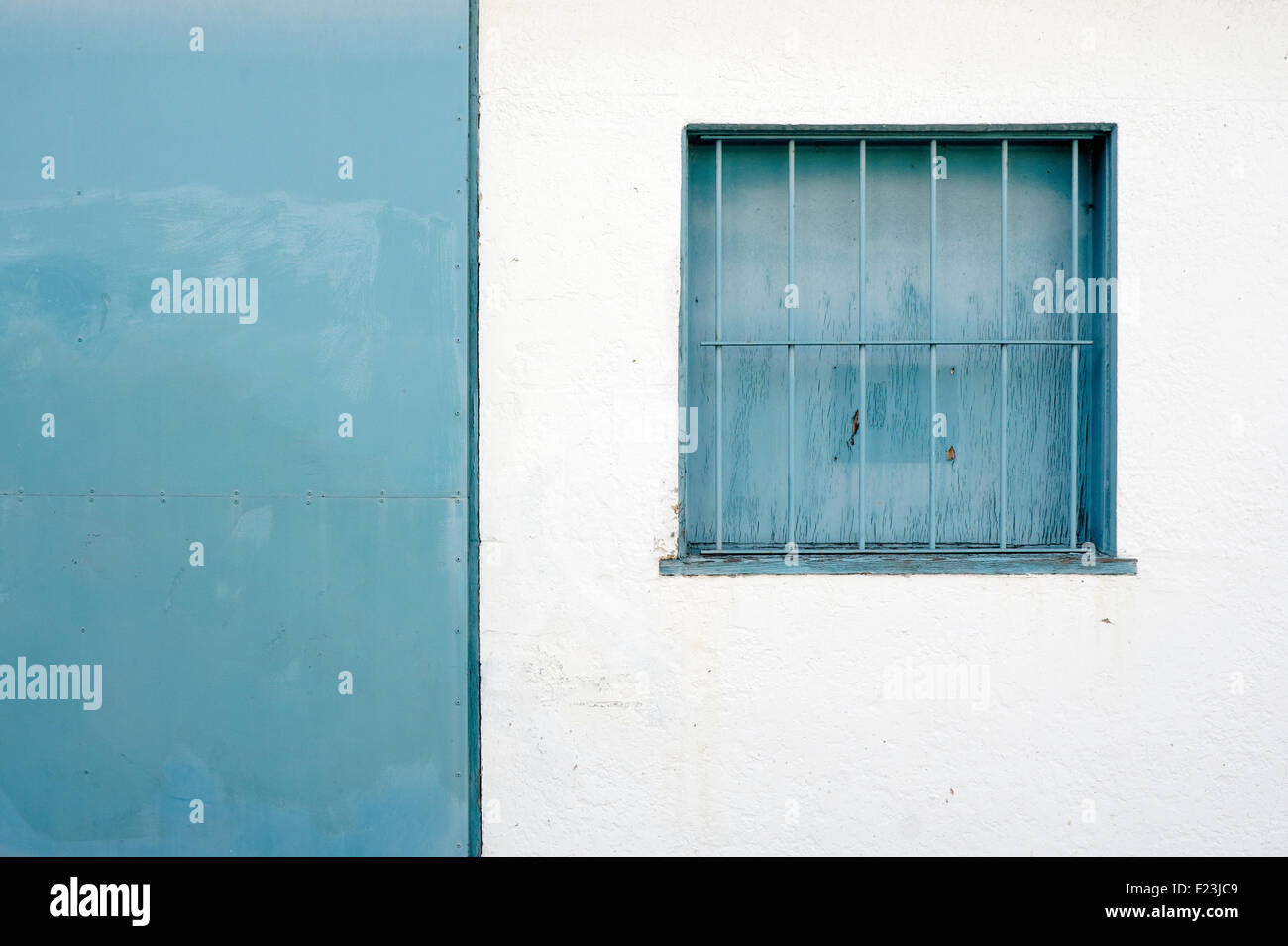 blue-barred-square-window-against-a-whit