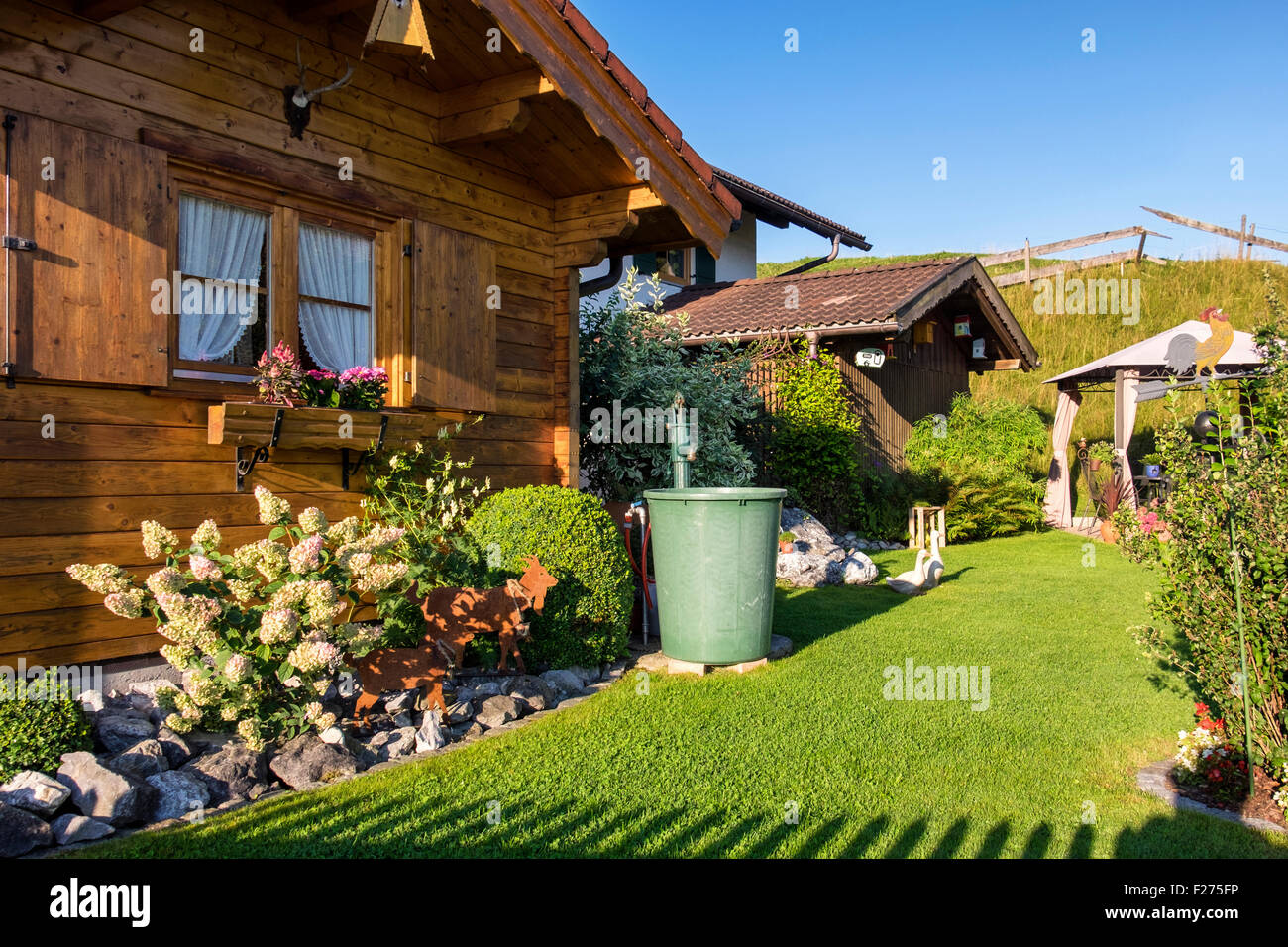 germany bavaria typical wooden house exterior and garden
