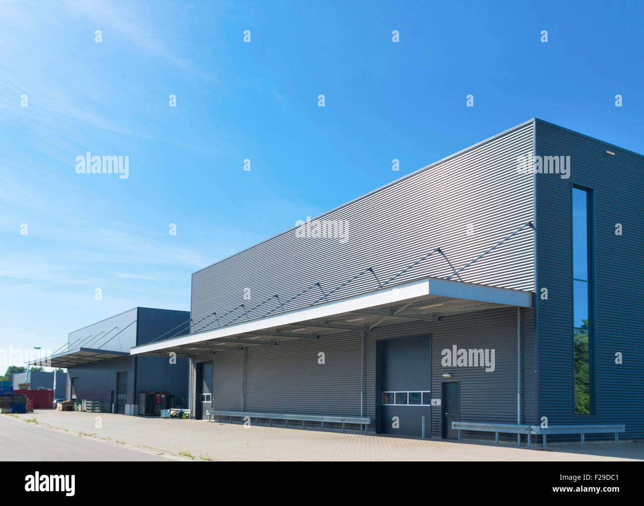 Exterior of a modern warehouse building against a blue sky for Warehouse building design