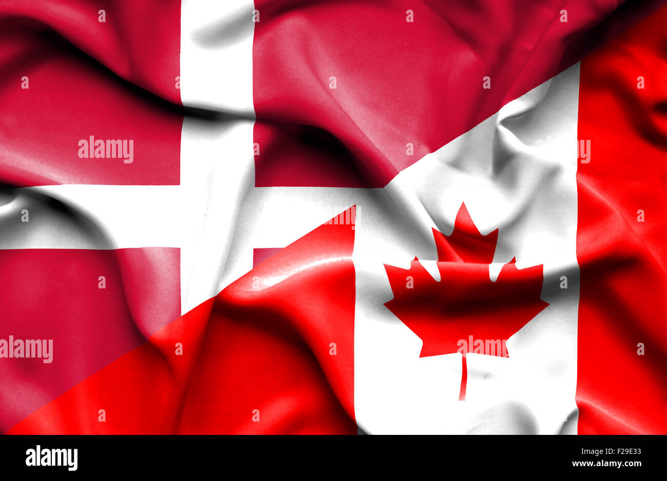 waving flag of canada and denmark stock photo royalty free image