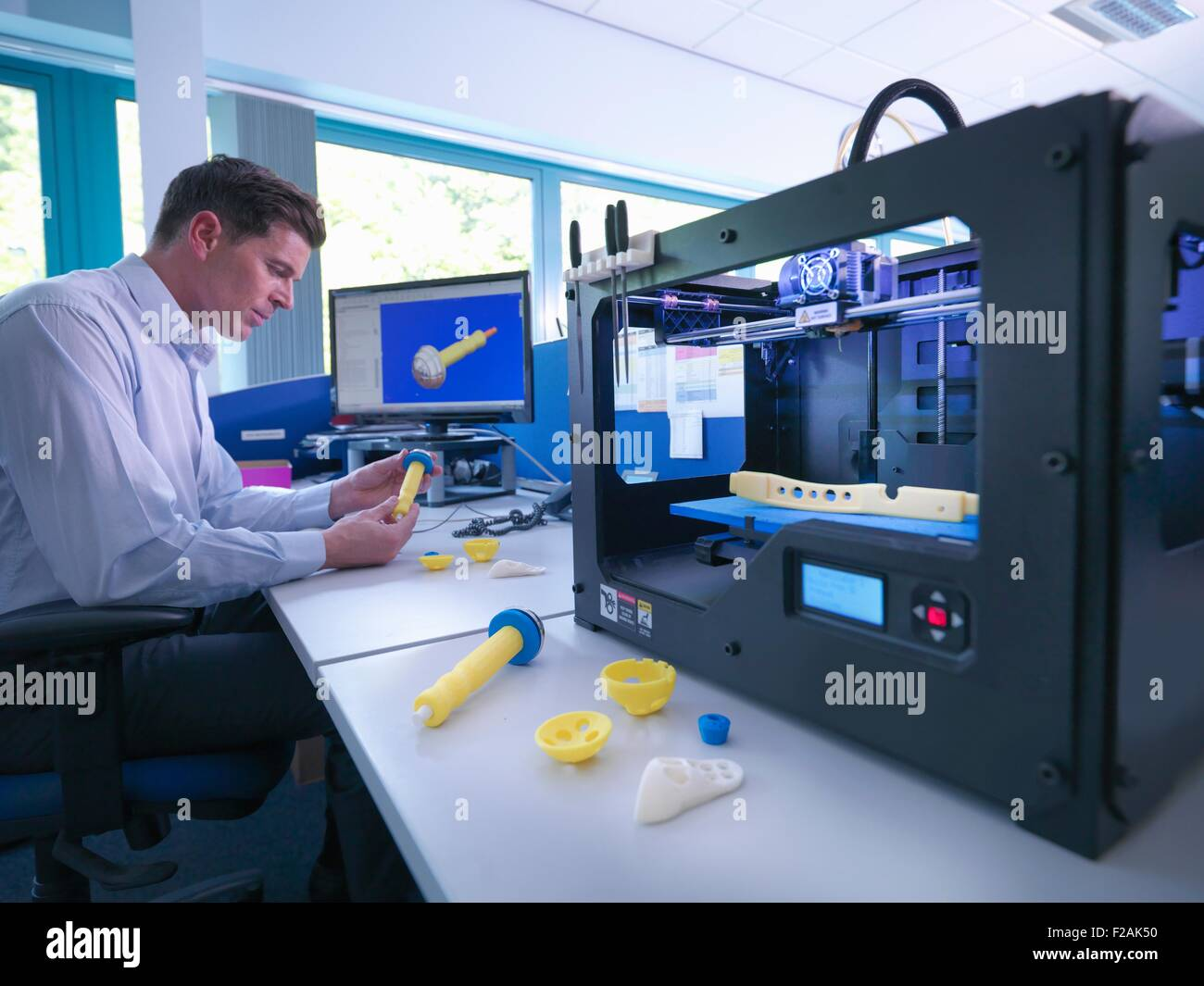 medical product designer with 3d printing machine with cad