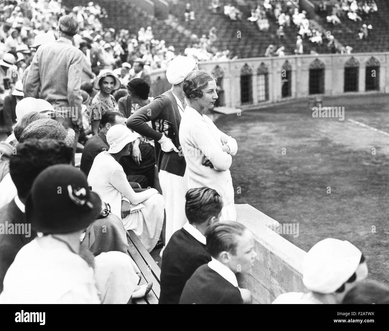 Helen Wills Moody watching tennis match at Forest Hills Long