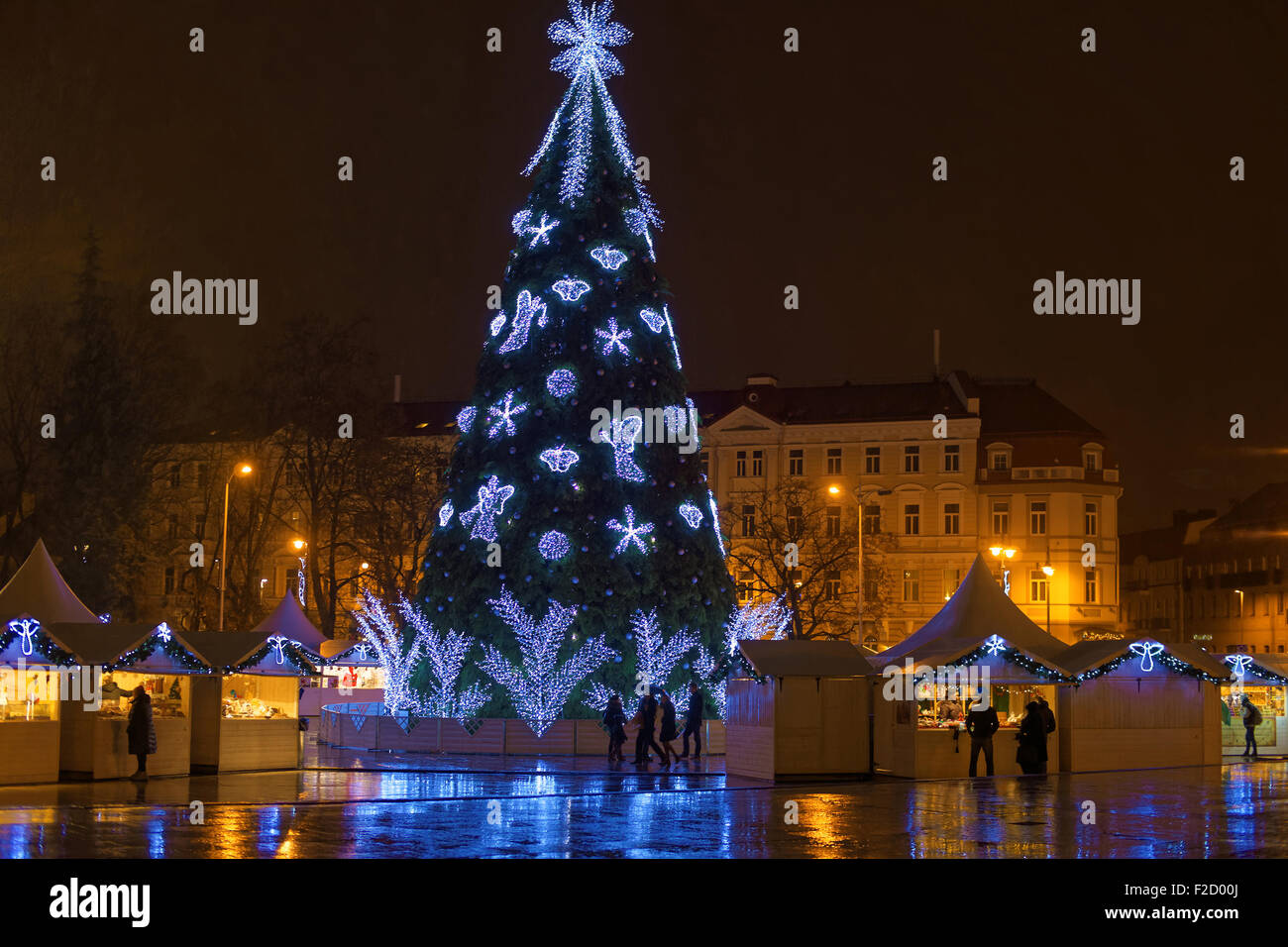stock photo traditional european christmas market in vilnius lithuania at night christmas tree decorated with angels snowflakes and blue lights - European Christmas Tree