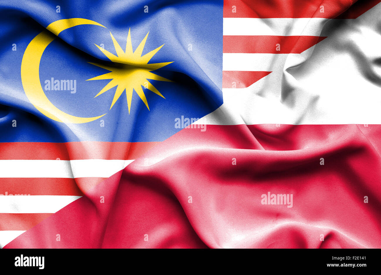 waving flag of poland and malaysia stock photo royalty free image
