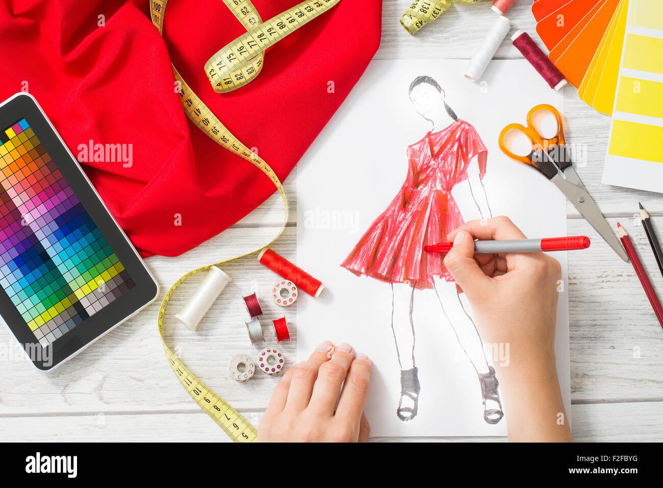 Fashion designer working in studio close up design stock for To be a fashion designer