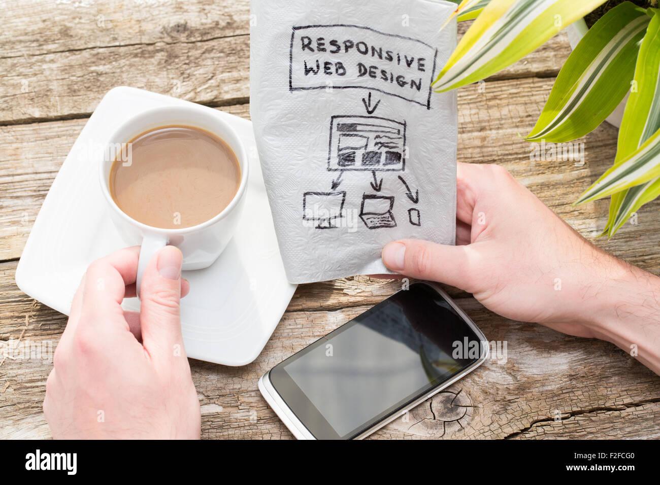 Web designer holding a blueprint of a new mobile application stock web designer holding a blueprint of a new mobile application responsive web design concept malvernweather Choice Image
