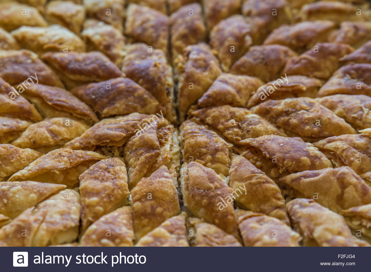 Turkish Pistachio Pastry Dessert, Baklava On A Tray And Wooden Table